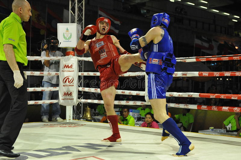 Amateur Muaythai World Championships. Fighters compete in a match in the Amateur Muaythai World Championships at the Thai National Stadium on March 18, 2013 in stock photo