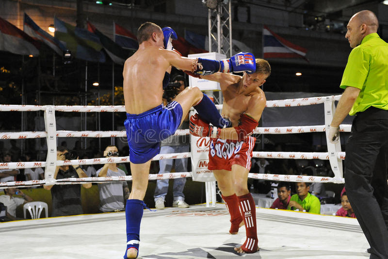 Muaythai World Championships. Fighters compete in a match in the WMF Muaythai World Championships at the Thai National Stadium on March 22, 2013 in Bangkok royalty free stock photography