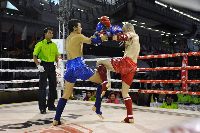 Muaythai World Championships. Fighters compete in a match in the WMF Muaythai World Championships at the Thai National Stadium on March 22, 2013 in Bangkok stock photos