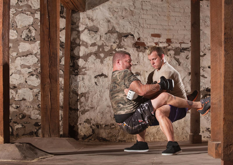 Download Fighters Doing Guard Situps Stock Image - Image: 28125409