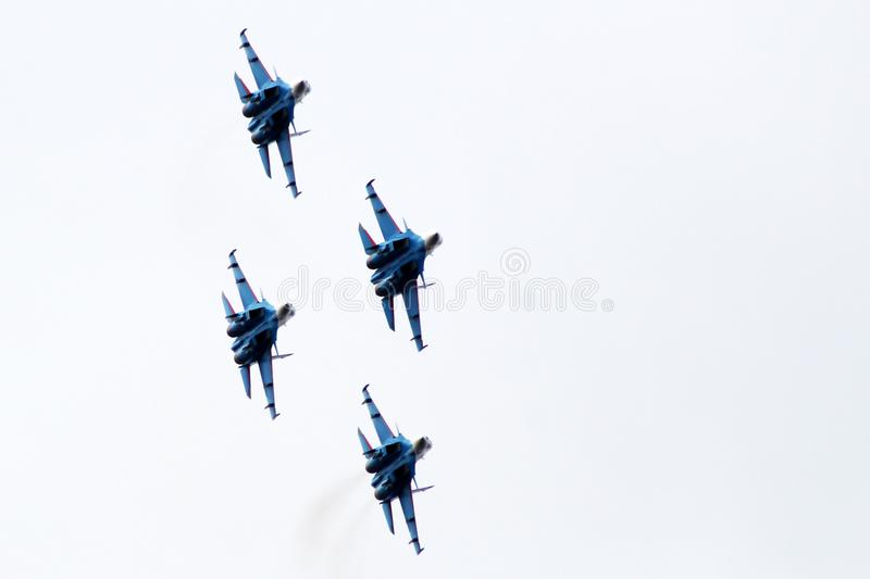 Fighters in the sky, the flight of the aircraft, a beautiful Airshow. Outdoors stock photos