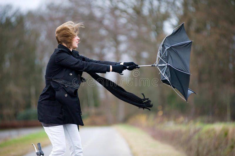 Fighting against the wind stock photography