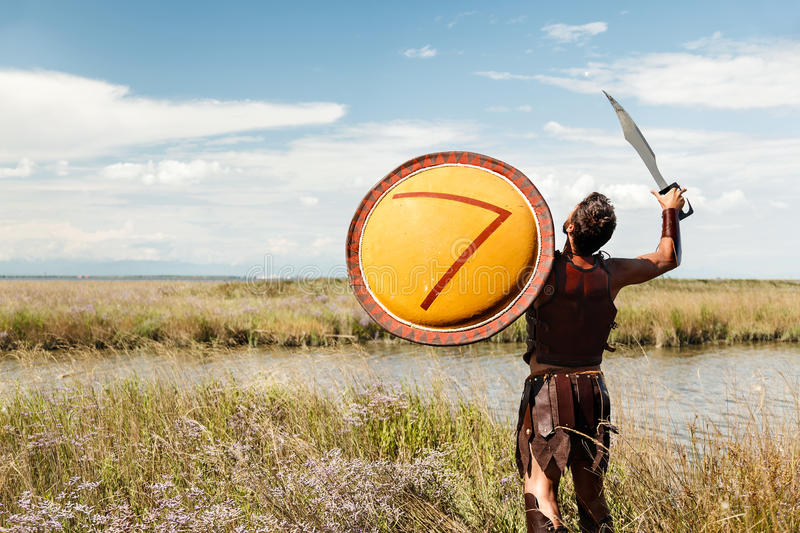 Fighting ancient warrior in landscape background stock image