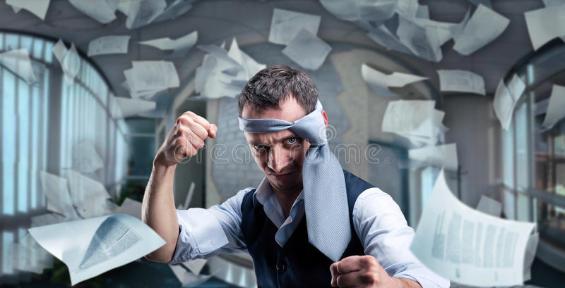 Fighting businessman with a tie on his head royalty free stock photo