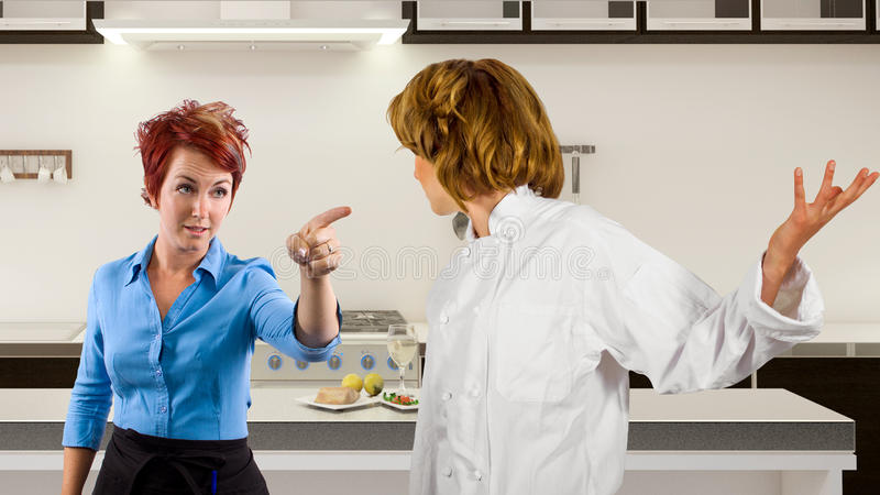 Fighting Chef and Waitress royalty free stock photography
