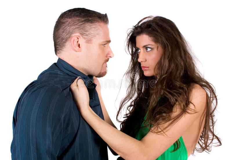 Fighting couple. A couple in the middle of a physical fight royalty free stock photography