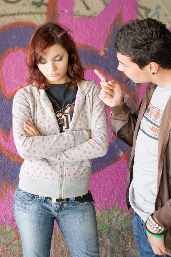 Fighting couple. Young woman and man having an argument stock photos