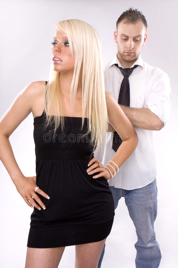 Fighting couple. Looking couple arguing - blonde girl blonde man stock photos