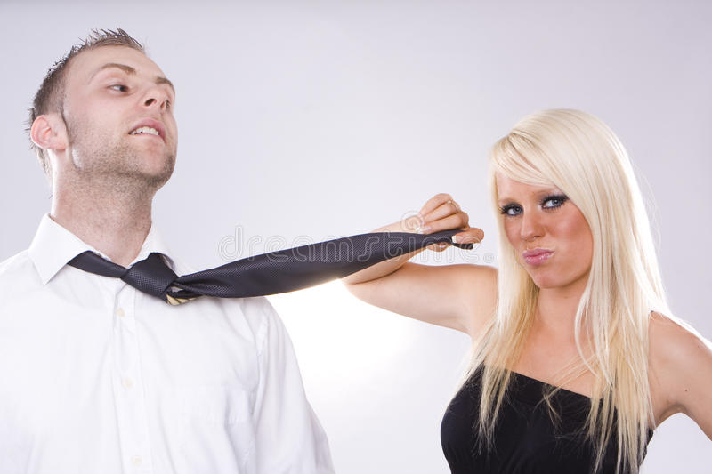 Fighting couple. Looking couple arguing - blonde girl blonde man stock image