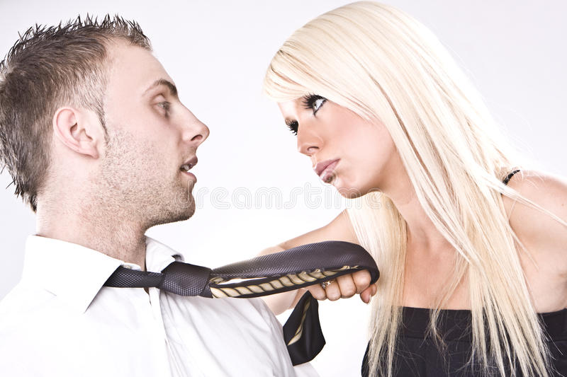 Fighting couple. Looking couple arguing - blonde girl blonde man royalty free stock images