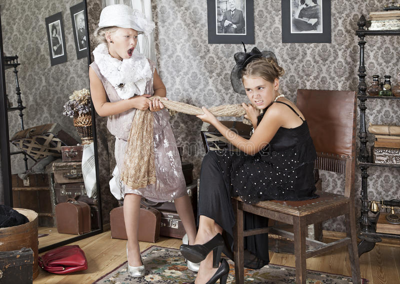 Fighting for a dress stock images