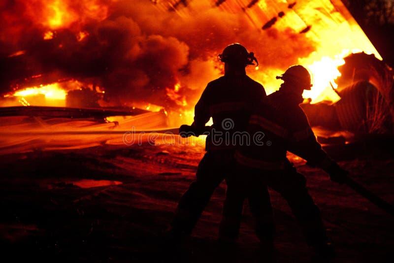 Fighting fire stock photos