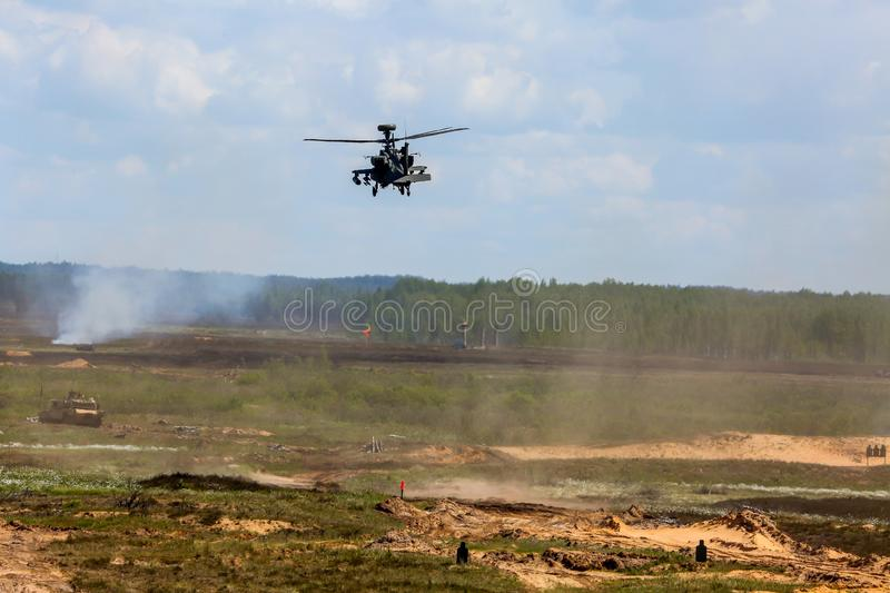 Fighting helicopter in military training Saber Strike in Latvia. UH-60 Blackhawk and Apache. International Military Training `Saber Strike 2017`, Adazi, Latvia royalty free stock photo