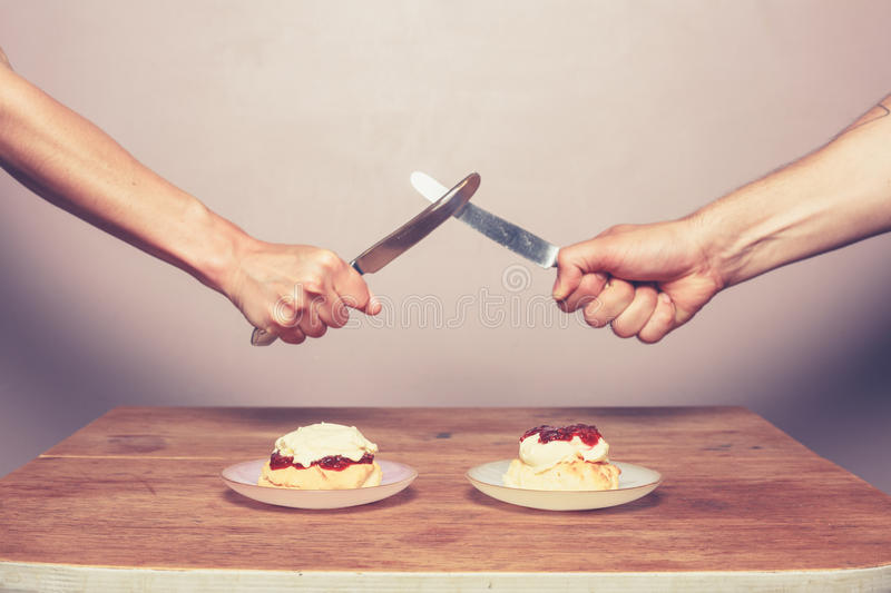 Fighting over cream tea royalty free stock photography