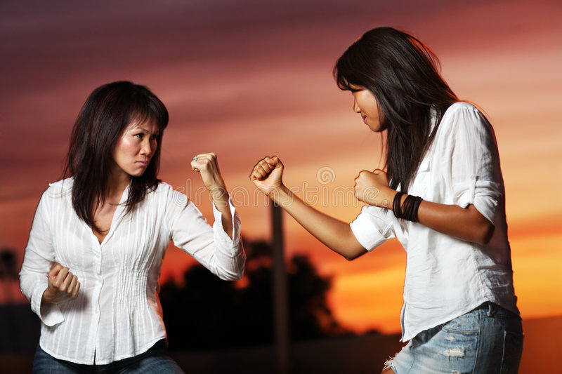 Fighting women stock images