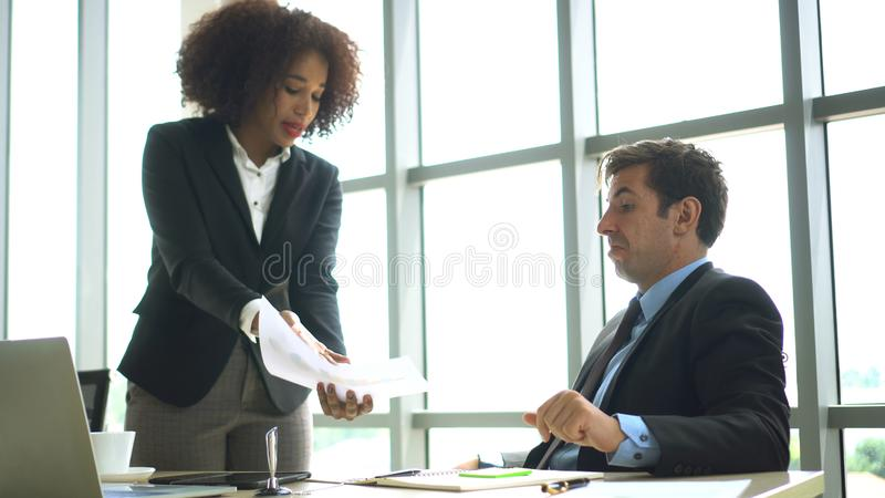 Fighting at work international colleauge argue on business matters. Fighting at work international colleauge argue business matters royalty free stock photo