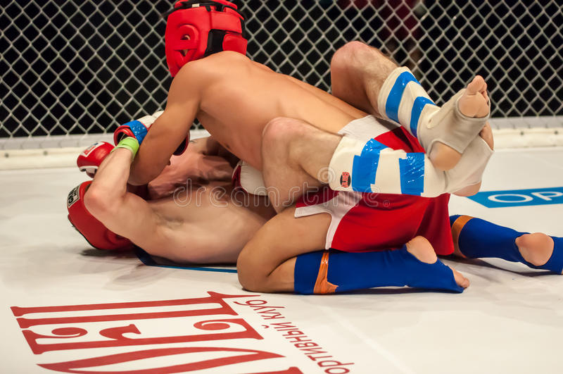 Fights without rules or MMA. Orenburg, Russia - 21.02.2015: Fight in mixed martial arts fighters on the open cup of Orenburg region mixed martial art (MMA) or stock image
