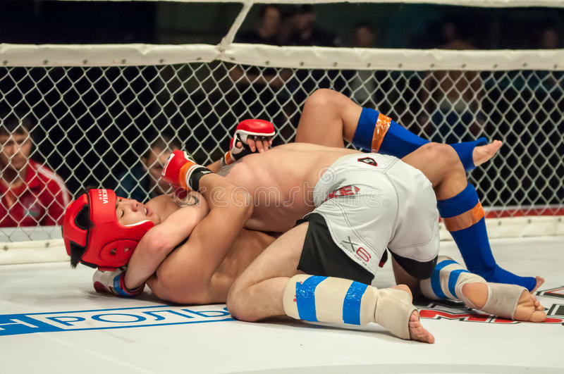 Fights without rules or MMA. Orenburg, Russia - 21.02.2015: Fight in mixed martial arts fighters on the open cup of Orenburg region mixed martial art (MMA) or stock photography