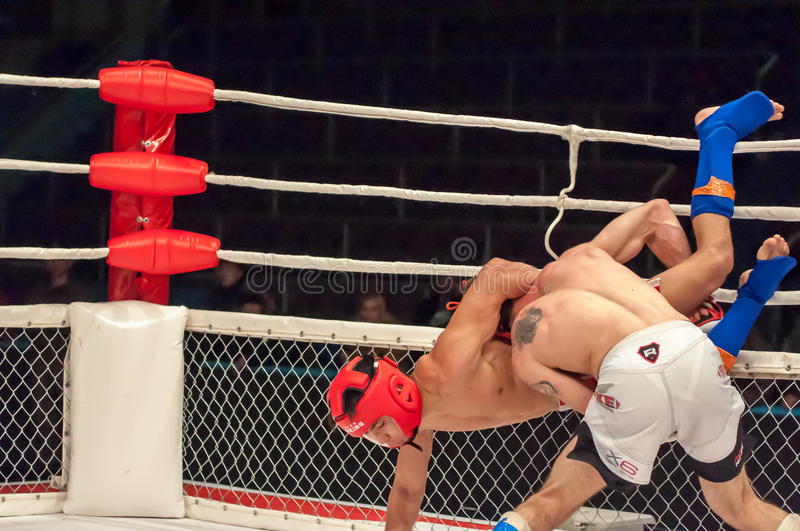 Fights without rules or MMA. Orenburg, Russia - 21.02.2015: Fight in mixed martial arts fighters on the open cup of Orenburg region mixed martial art (MMA) or royalty free stock photos
