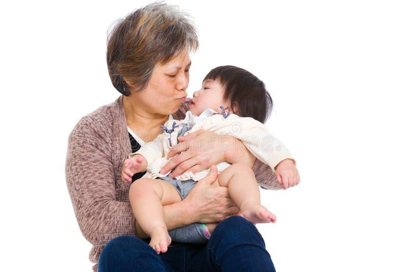 Figlia del bambino e della nonna fotografie stock libere da diritti