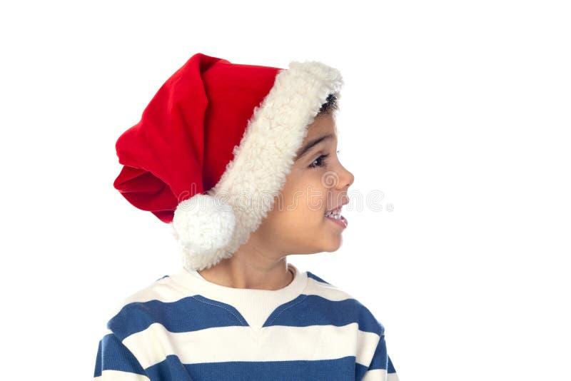 Figlio goloso con cappello di Natale immagine stock libera da diritti
