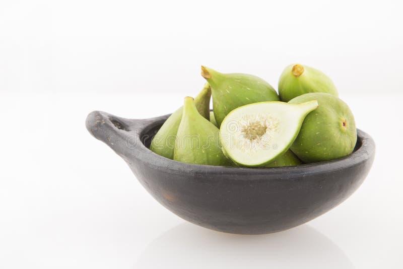 Figos verdes no fundo branco - Ficus Carica imagem de stock royalty free