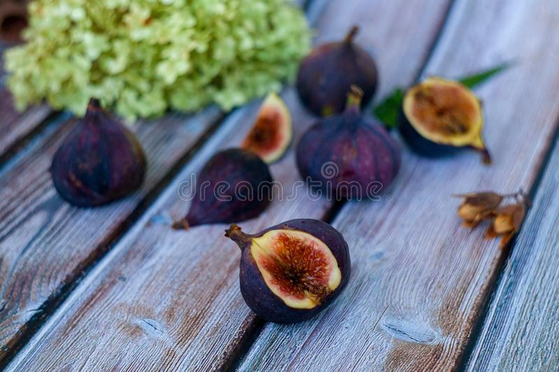 Figs and apricots on a wooden surface. Healthy eating concept royalty free stock photos