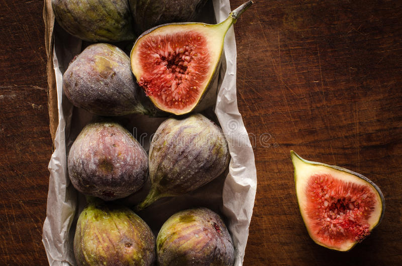 Figs in the box on wooden table royalty free stock image