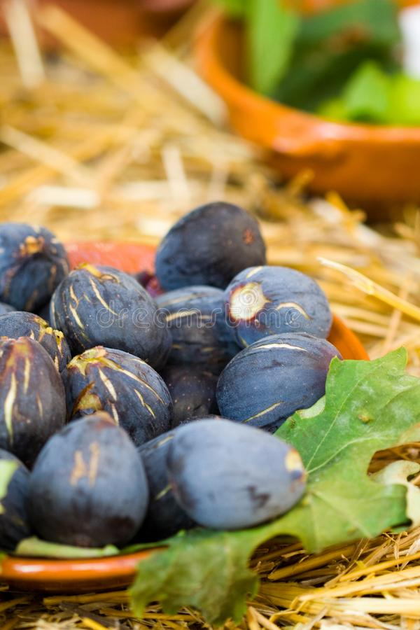 Figs on a plate. Figs in a market exposition. Natural fruits stock images