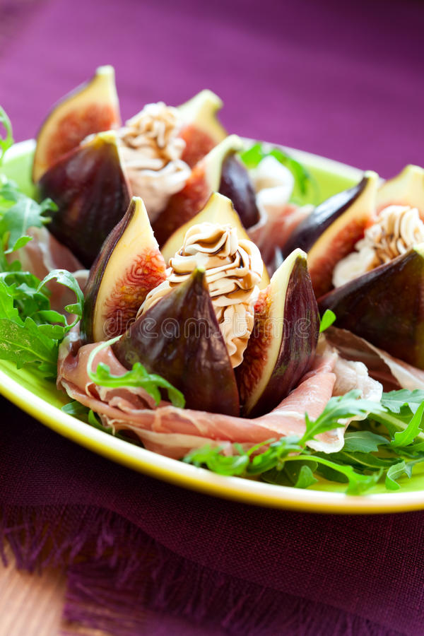 Figs with prosciutto,cheese and balsamic vinegar stock photos