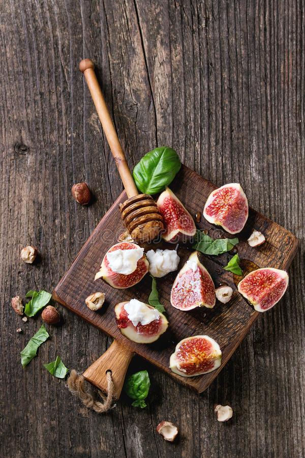 Figs with ricotta and honey royalty free stock images