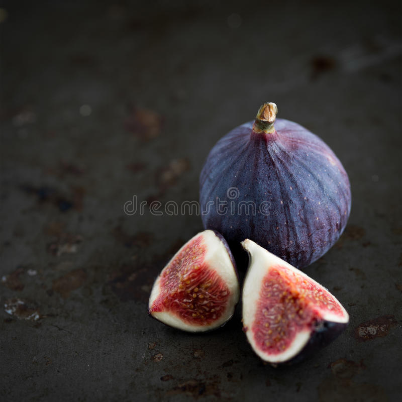 Figs on rustic table in dark tones royalty free stock photo