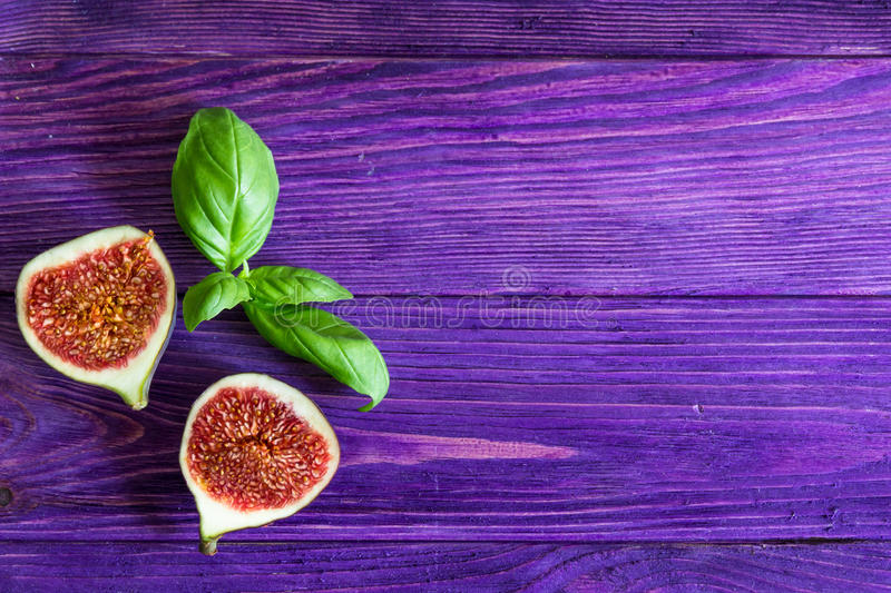 Figs on wooden purple background stock photography