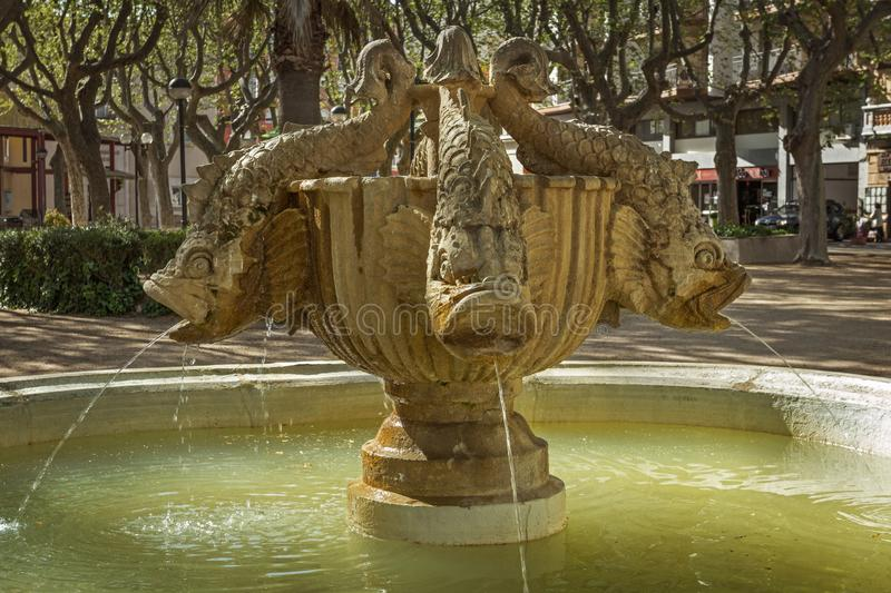Fish fountain in Figueres. Figueres, Spain - 30 March 2017: Fish fountain pouring water in sunny weather at Figueres train station royalty free stock images