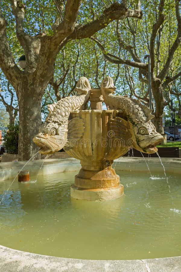 Fish fountain in Figueres. Figueres, Spain - 30 March 2017: Fish fountain pouring water in sunny weather at Figueres train station royalty free stock photography