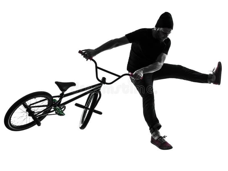 Figura acrobatica siluetta del bmx dell'uomo fotografia stock