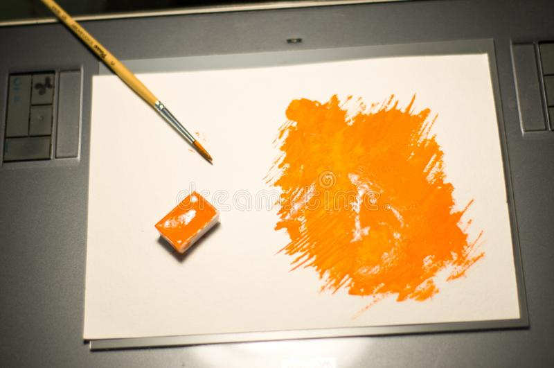 Figura alaranjada pintada com aquarela foto de stock