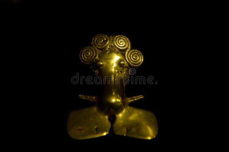 Figura antica di Costa Rica fatta di oro dai nativi fotografia stock