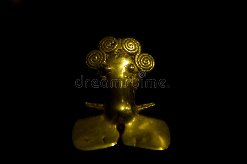 Figura antigua de Costa Rica hecha del oro por los naturales fotografía de archivo
