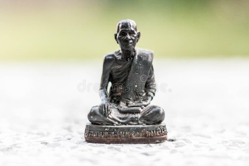 Figura de Buddha que se sienta imagen de archivo
