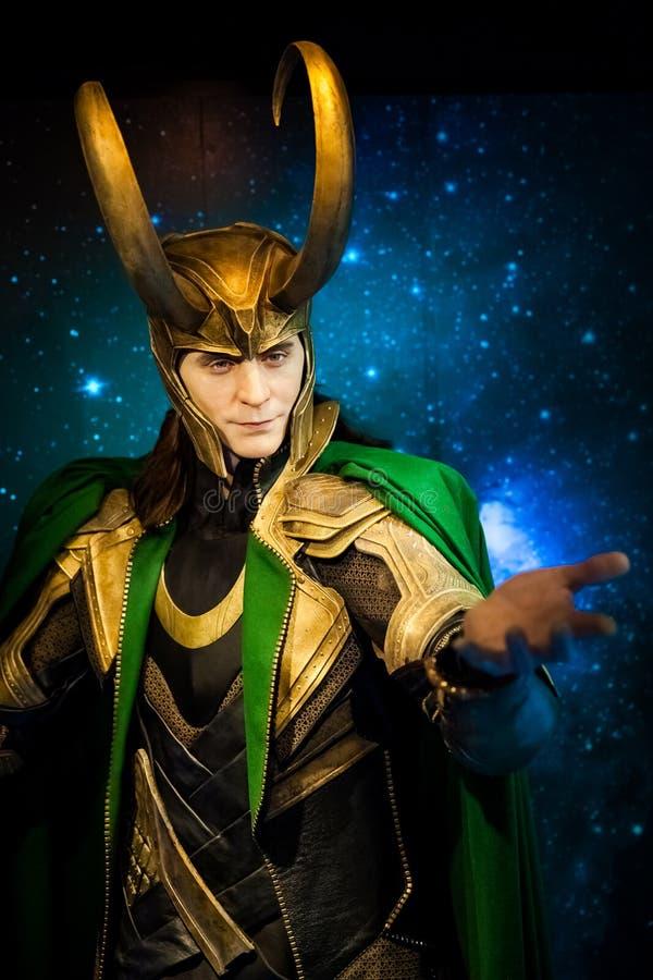 Figura de cera del carácter ficticio del Loki de los cómic americanos en museo de señora Tussauds Wax en Amsterdam, Países Bajos imagenes de archivo