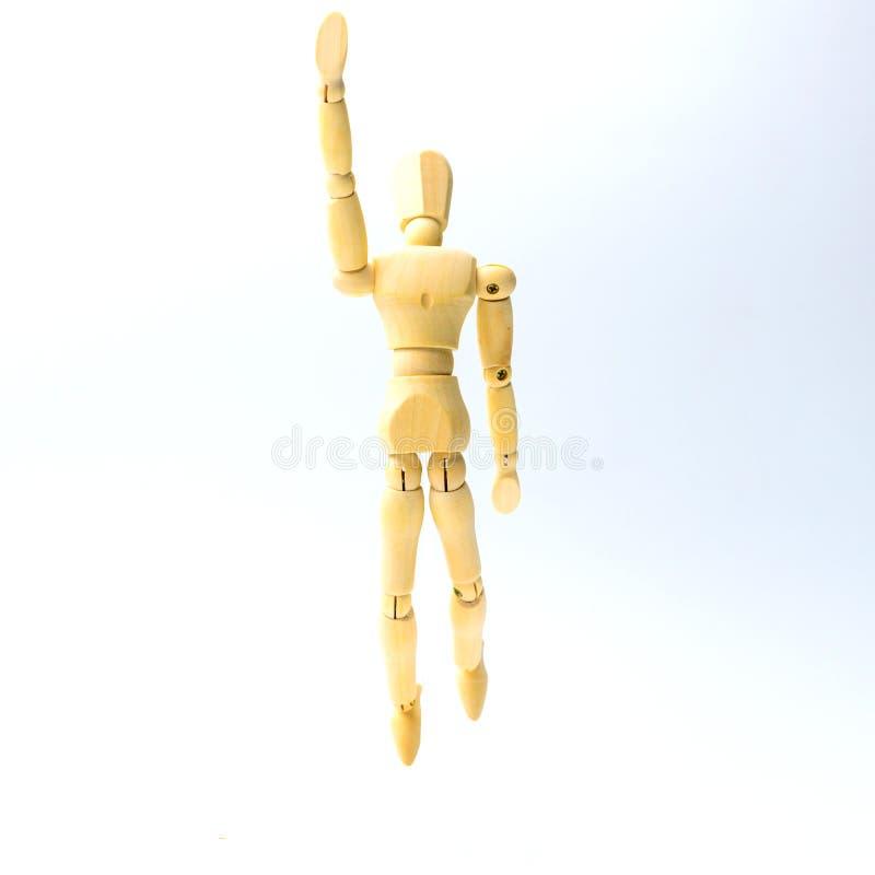 Figura de madeira boneca com emoção de salto para o engodo do negócio do sucesso imagem de stock