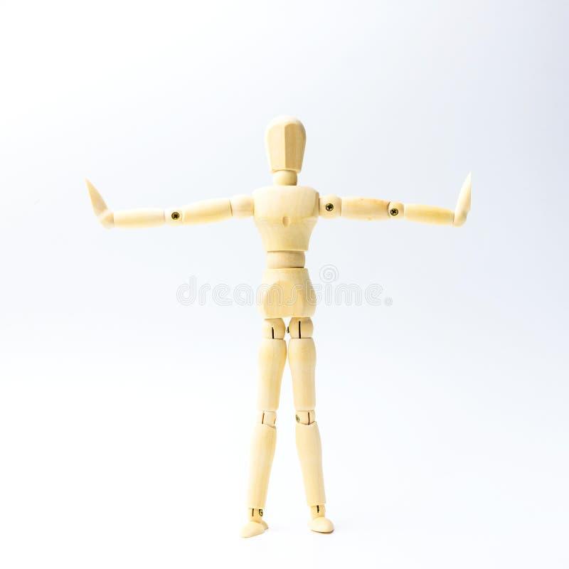 A figura de madeira boneca com estende a emoção dos braços para o engodo do exercício imagem de stock royalty free
