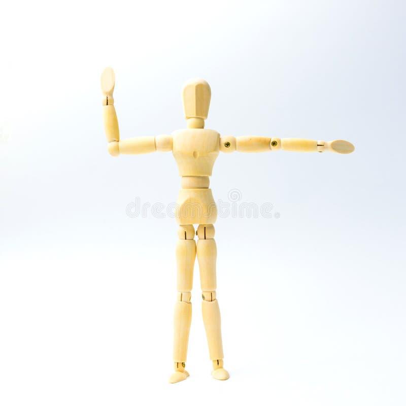 A figura de madeira boneca com estende a emoção dos braços para o engodo do exercício imagem de stock