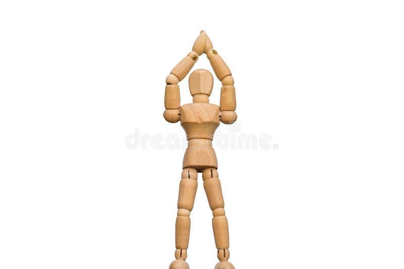 A figura de madeira isolada faz uma pose da vitória foto de stock