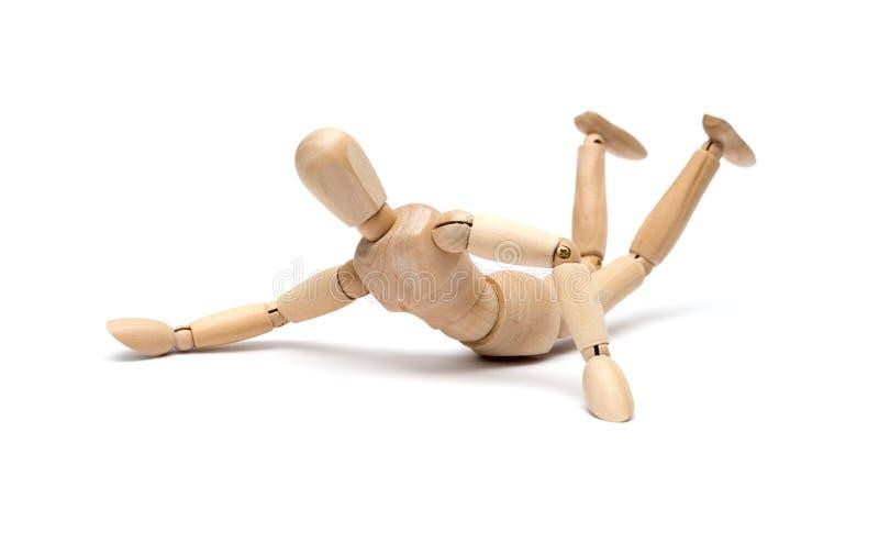 Figura de madeira mannequin que cai para baixo fotos de stock