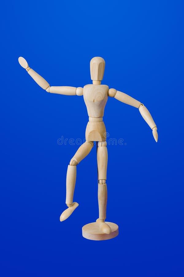 Figura de madera de baile del juguete en azul fotos de archivo libres de regalías