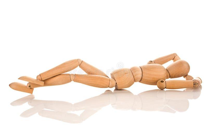 Figura de madera reclinación imagen de archivo