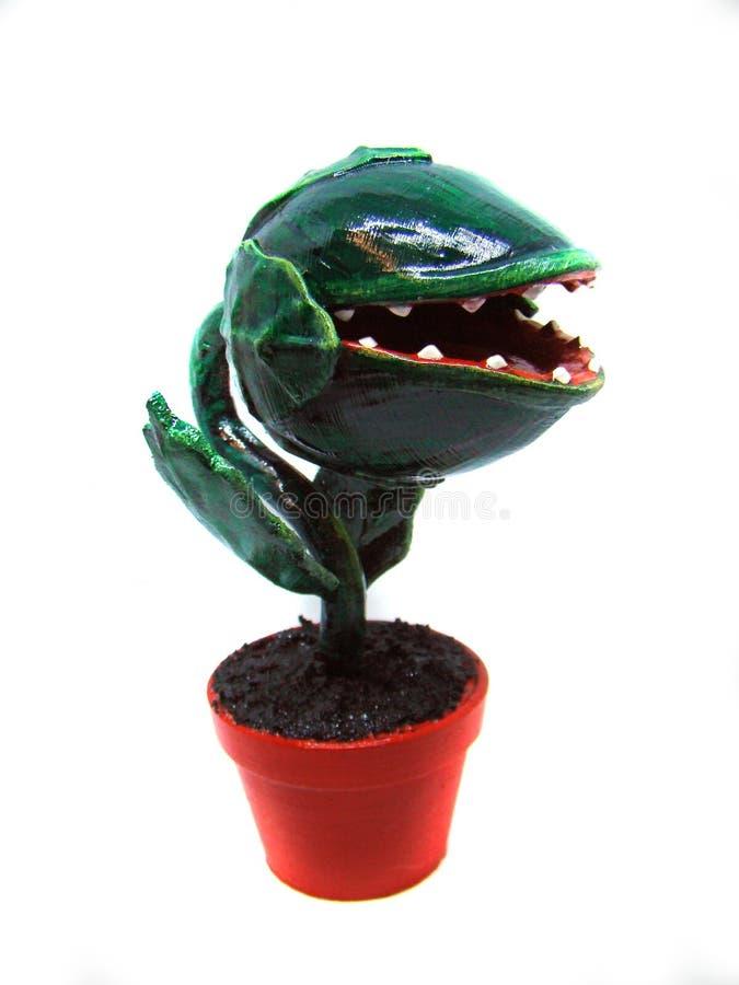 Figura de plástico vegetal carnívoro em um pote imagens de stock