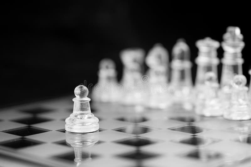 Figura del ajedrez, estrategia del concepto del negocio, dirección, equipo y su foto de archivo